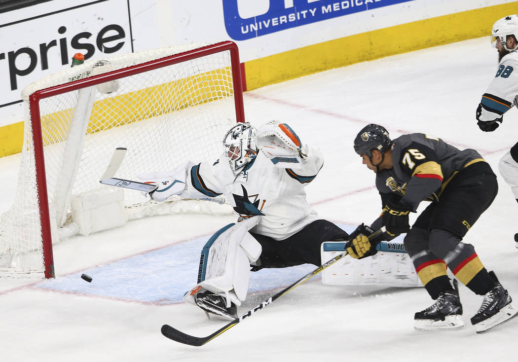 Golden Knights right wing Ryan Reaves (75) tries to score against San Jose Sharks goaltender Martin Jones (31) during the first period of an NHL hockey game at T-Mobile Arena in Las Vegas on Satur ...