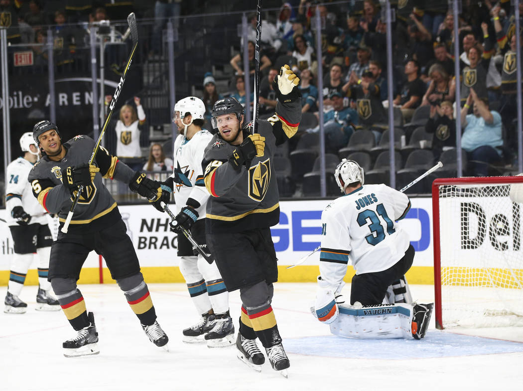 Golden Knights center Oscar Lindberg, center, celebrates his goal against San Jose Sharks goaltender Martin Jones (31) during the second period of an NHL hockey game at T-Mobile Arena in Las Vegas ...