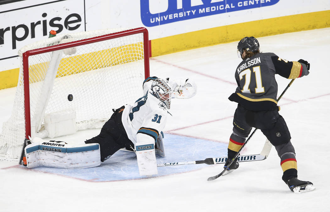 Golden Knights center William Karlsson (71) scores against San Jose Sharks goaltender Martin Jones (31) during the third period of an NHL hockey game at T-Mobile Arena in Las Vegas on Saturday, Ma ...