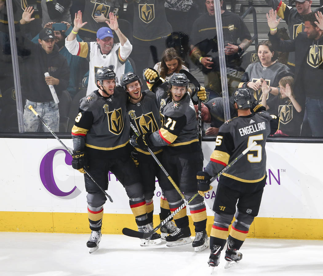 Golden Knights players celebrate the goal by center William Karlsson (71) during the third period of an NHL hockey game against the San Jose Sharks at T-Mobile Arena in Las Vegas on Saturday, Marc ...