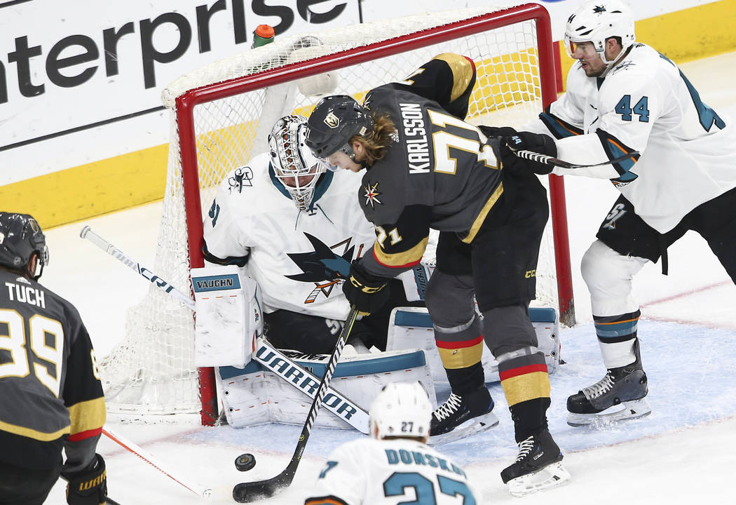 Golden Knights center William Karlsson (71) tries to score against San Jose Sharks goaltender Martin Jones (31) during the third period of an NHL hockey game at T-Mobile Arena in Las Vegas on Satu ...