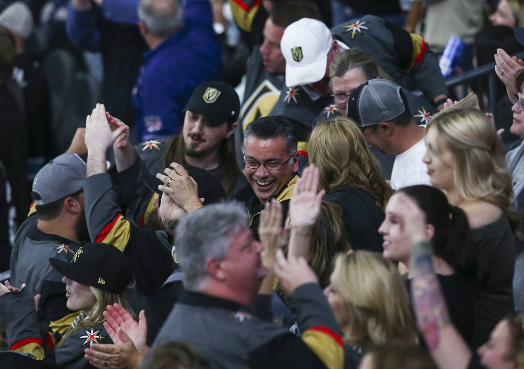 Golden Knights fans celebrate a goal by center William Karlsson (71) during the third period of an NHL hockey game against the San Jose Sharks at T-Mobile Arena in Las Vegas on Saturday, March 31, ...
