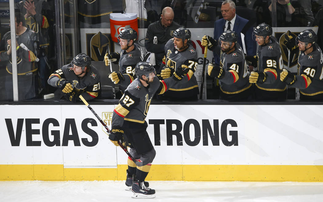 Golden Knights defenseman Shea Theodore (27) celebrates his goal against the San Jose Sharks during the first period of an NHL hockey game at T-Mobile Arena in Las Vegas on Saturday, March 31, 201 ...