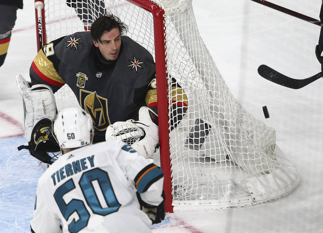 Golden Knights goaltender Marc-Andre Fleury (29) defends the goal as the puck passes by during the second period of an NHL hockey game against the San Jose Sharks at T-Mobile Arena in Las Vegas on ...