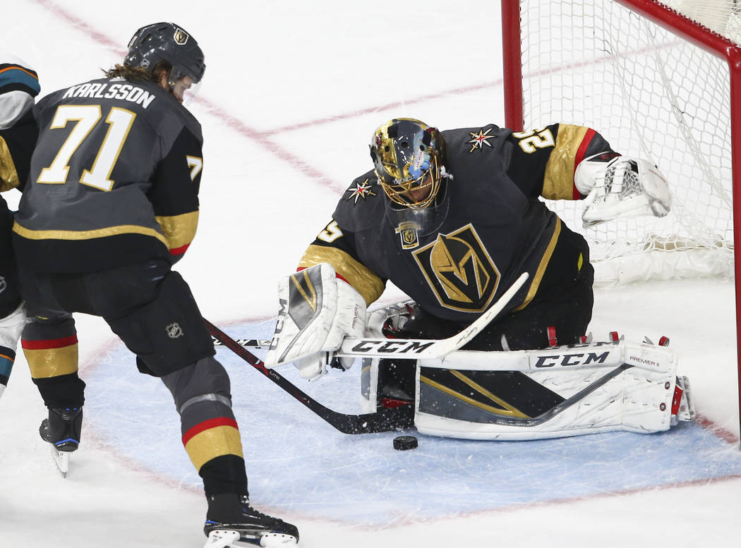 Golden Knights goaltender Marc-Andre Fleury (29) defends the goal as Golden Knights center William Karlsson (71) looks on during the second period of an NHL hockey game against the San Jose Sharks ...