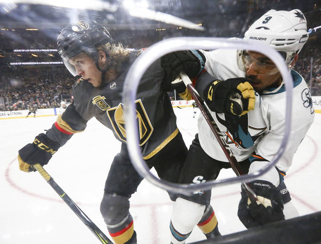 Golden Knights center William Karlsson (71) battles against San Jose Sharks left wing Evander Kane (9) during the second period of an NHL hockey game at T-Mobile Arena in Las Vegas on Saturday, Ma ...