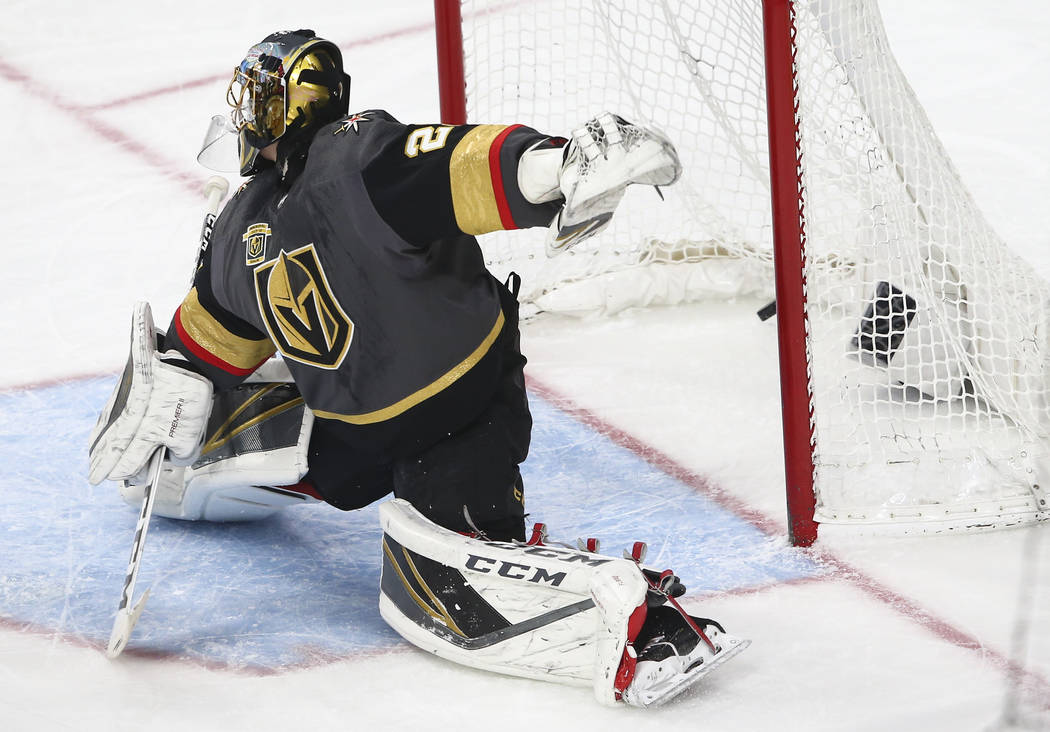Golden Knights goaltender Marc-Andre Fleury (29) gets scored on by the San Jose Sharks during the first period of an NHL hockey game at T-Mobile Arena in Las Vegas on Saturday, March 31, 2018. Cha ...