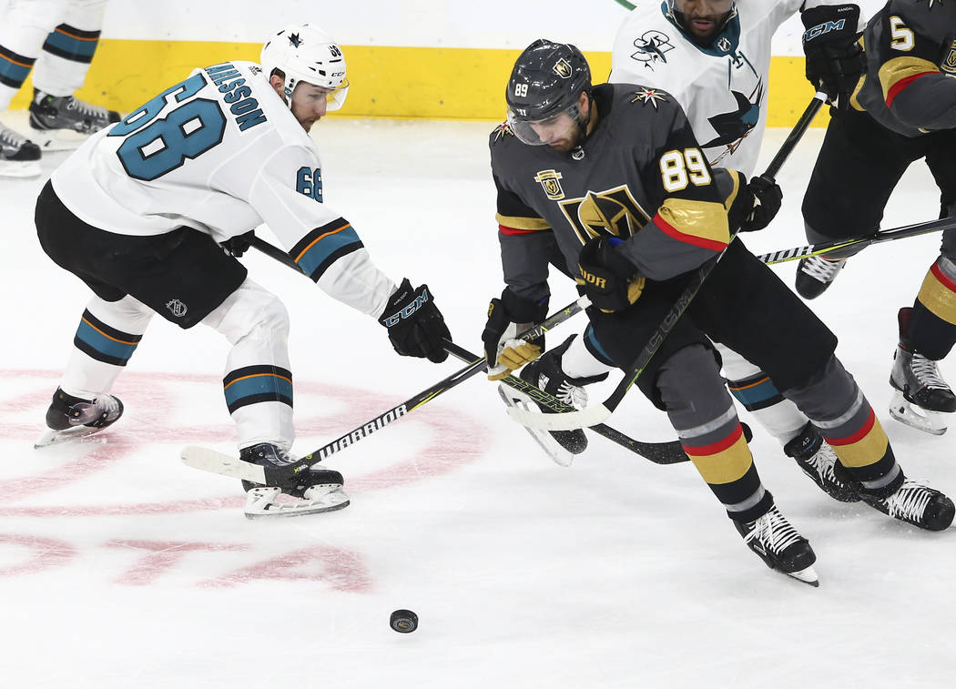 Golden Knights right wing Alex Tuch (89) moves the puck past San Jose Sharks center Melker Karlsson (68) during the first period of an NHL hockey game at T-Mobile Arena in Las Vegas on Saturday, M ...
