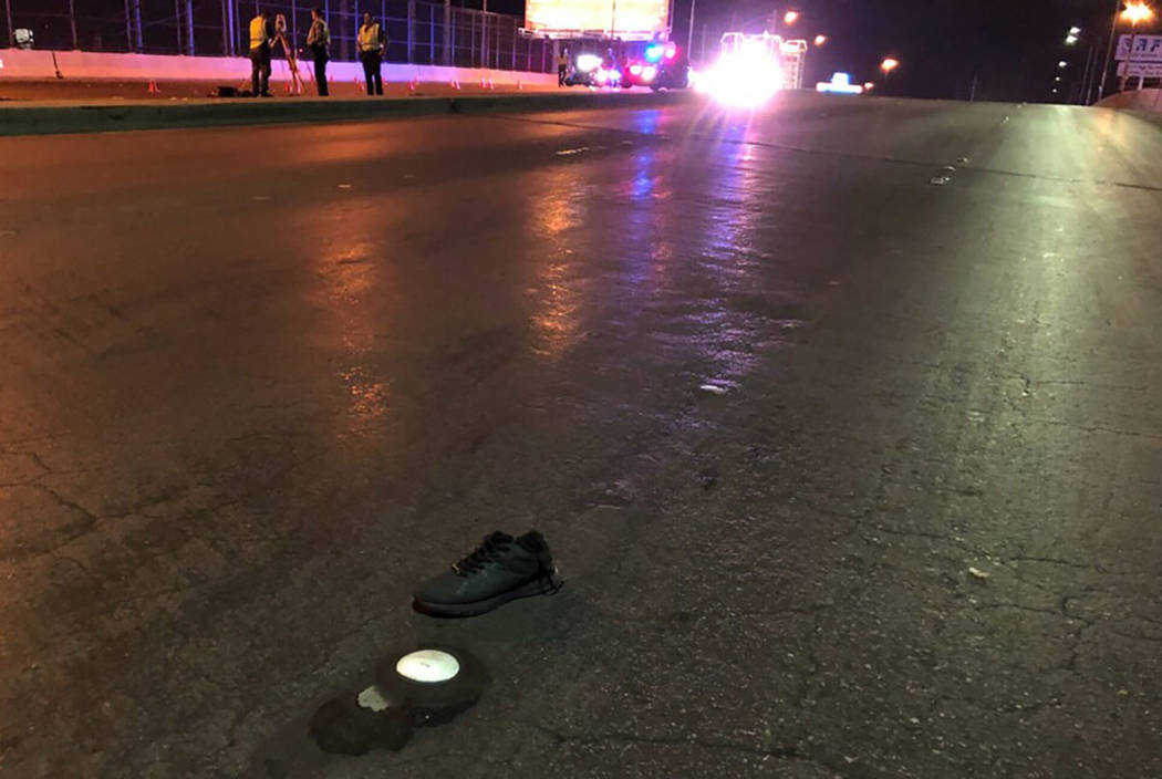 Nevada Highway Patrol troopers investigate the scene of a deadly crash in the eastbound lanes of Sahara Avenue at Industrial Road on Saturday night in Las Vegas. (NHP