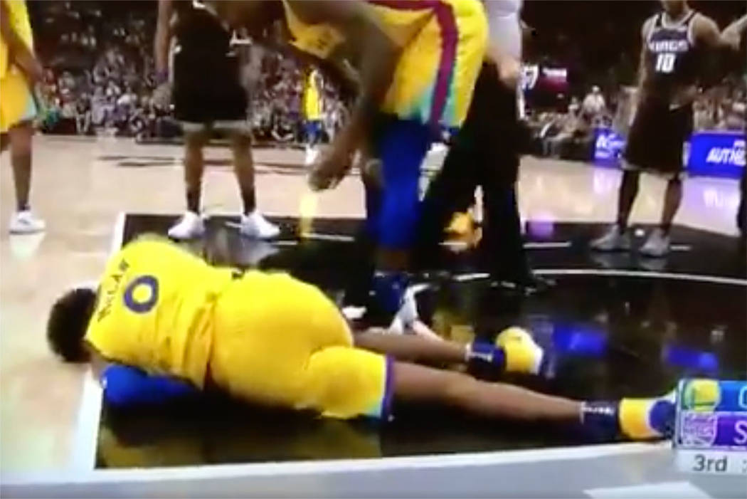 Warriors guard Patrick McCaw was taken away on a stretcher after he fell hard to the floor following a foul by Sacramento's Vince Carter on Saturday night. (screengrab from TV via Drew Shiller on  ...