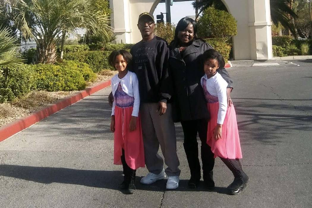Joseph Whacks, his wife, Ghowanda, and their twin girls, seen around Christmas 2017, pose outside the Tuscany Hotel and Casino where the Kline Fund of Summerlin put them up after the family became ...