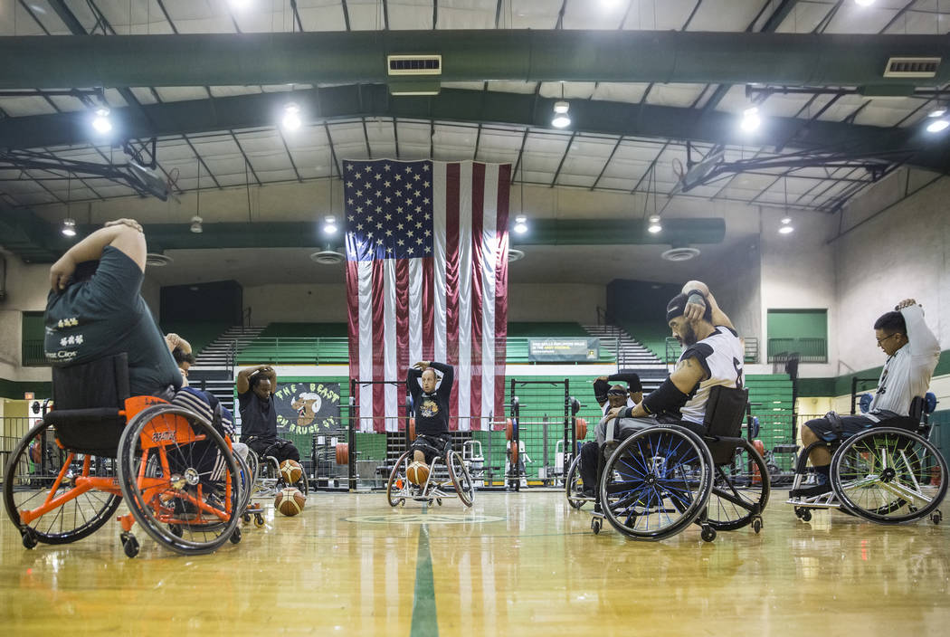 Players stretch before the start of practice for the Las Vegas Yuccas of the National Wheelchair Basketball Association on Tuesday, January 16, 2018, at Rancho High School, in Las Vegas. Benjamin  ...