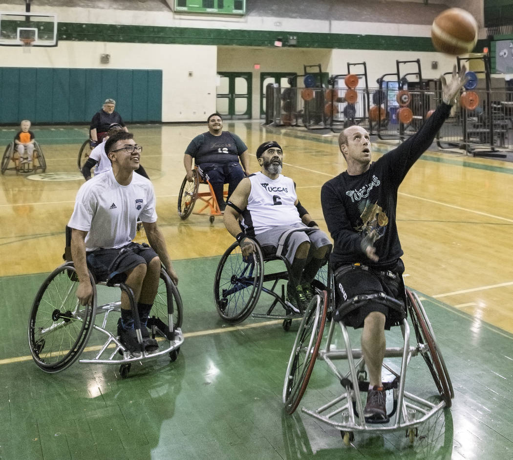 Nathan Carruth, right, drives to the basket during practice for the Las Vegas Yuccas of the National Wheelchair Basketball Association on Tuesday, January 16, 2018, at Rancho High School, in Las V ...