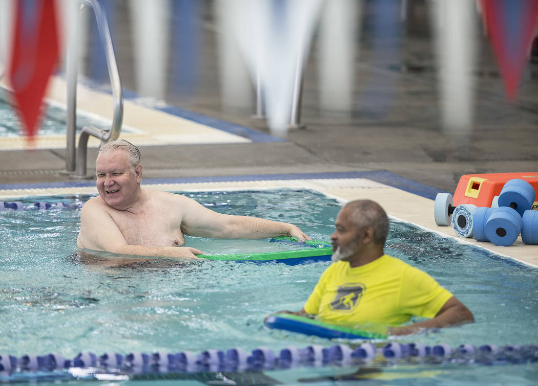 Army veteran Rodger Hemming, left, works out with retired Air Force sergeant Clarence Wright at the City of Las Vegas Municipal Pool on Tuesday, January 16, 2018, in Las Vegas. Benjamin Hager Las  ...