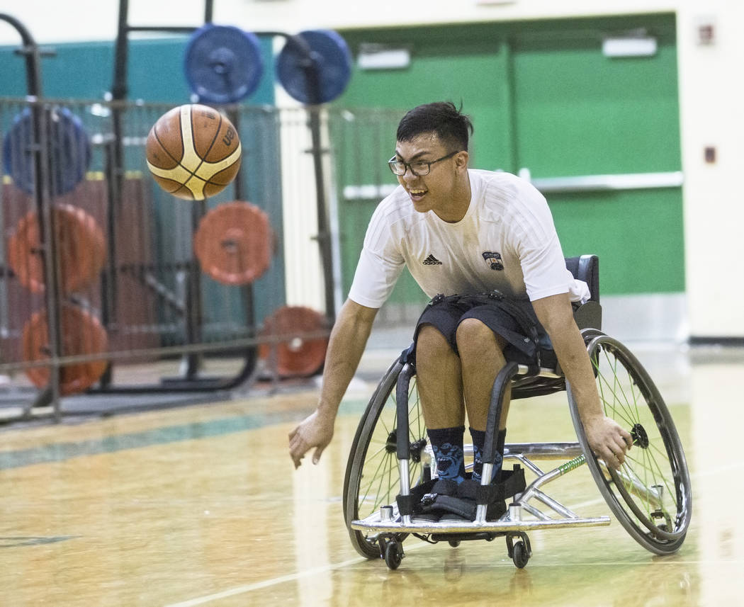 Cesar Robledo races towards a loose ball during practice for the Las Vegas Yuccas of the National Wheelchair Basketball Association on Tuesday, January 16, 2018, at Rancho High School, in Las Vega ...