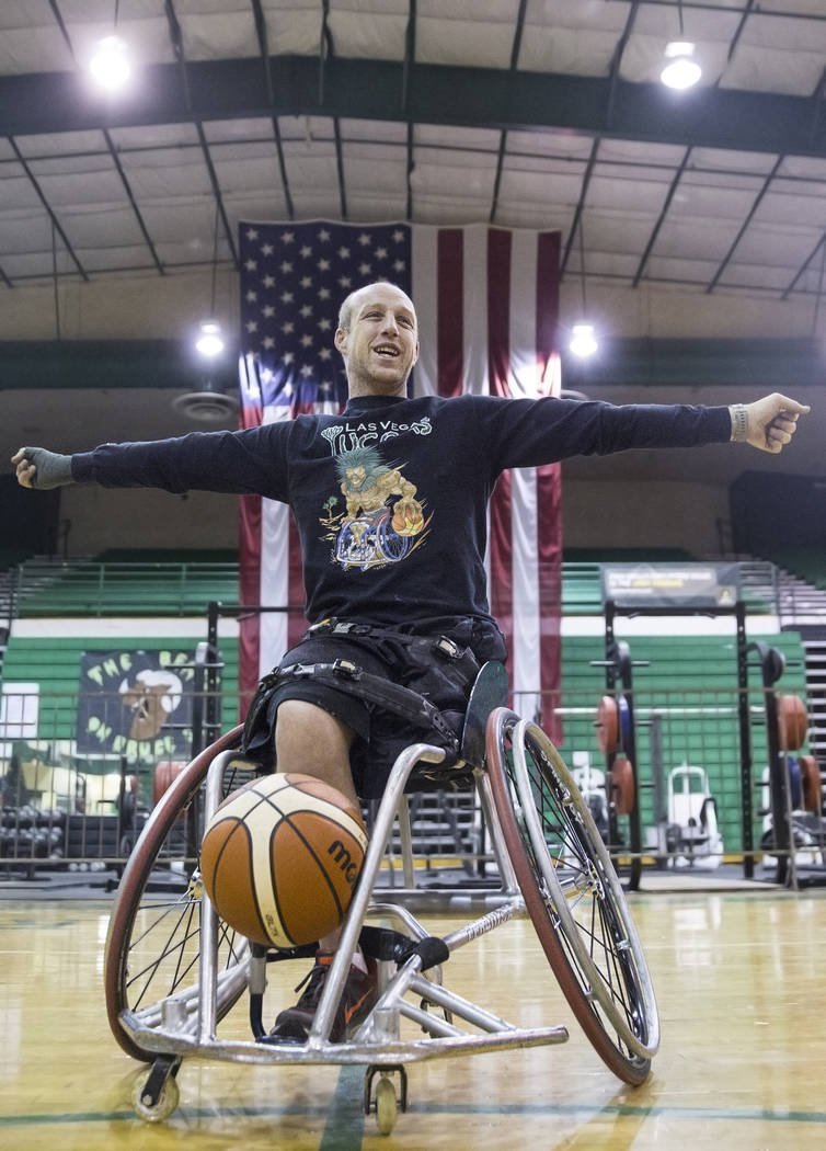 Nathan Carruth, coach and player for the Las Vegas Yuccas of the National Wheelchair Basketball Association, stretches before the start of practice on Tuesday, January 16, 2018, at Rancho High Sch ...