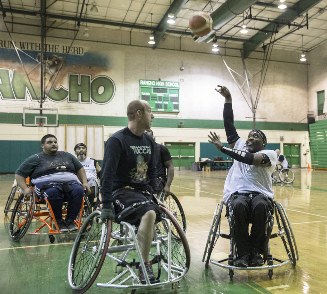 Larry Purfoy, right, shoots over Nathan Carruth during practice for the Las Vegas Yuccas of the National Wheelchair Basketball Association on Tuesday, January 16, 2018, at Rancho High School, in L ...