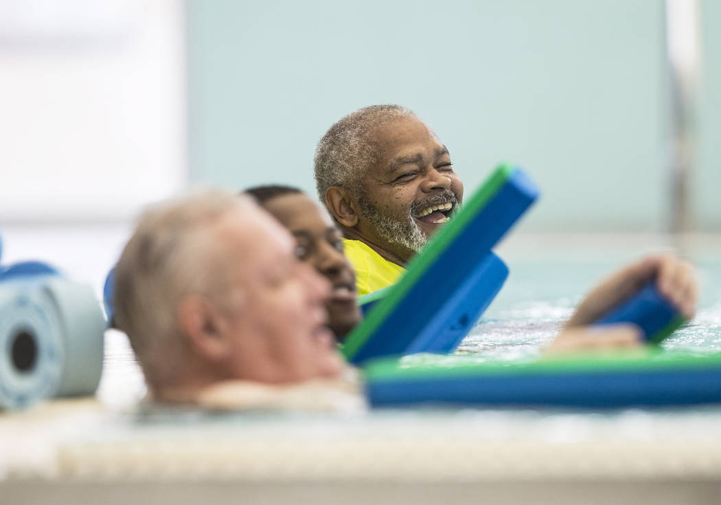 Retired Air Force sergeant Clarence Wright, right, shares  a laugh with his workout partners at the City of Las Vegas Municipal Pool on Tuesday, January 16, 2018, in Las Vegas. Benjamin Hager Las  ...