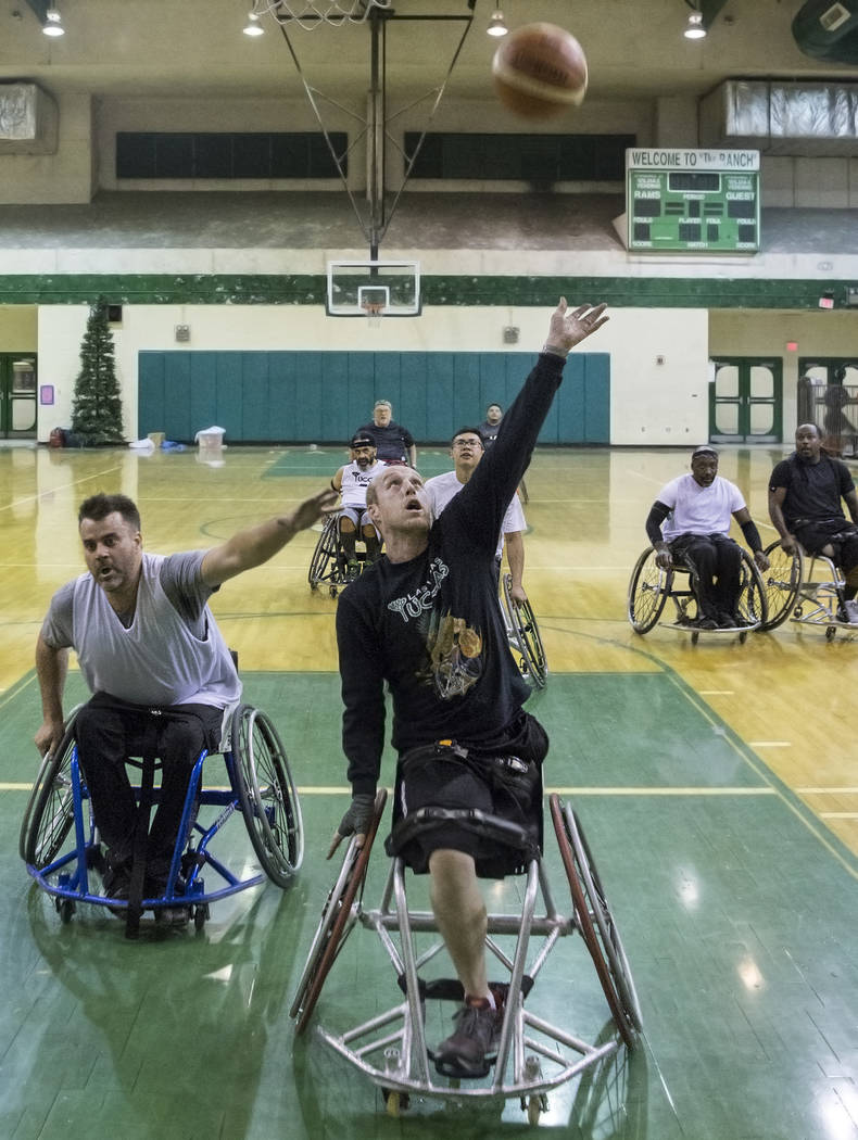 Nathan Carruth, middle, drives to the basket during practice for the Las Vegas Yuccas of the National Wheelchair Basketball Association on Tuesday, January 16, 2018, at Rancho High School, in Las  ...