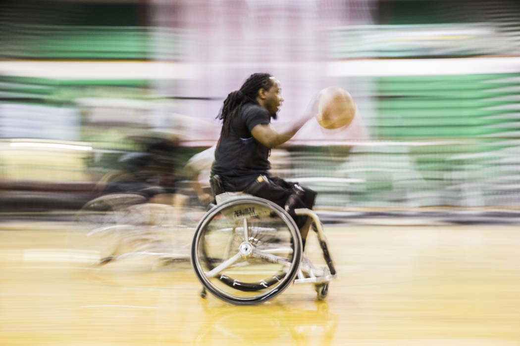 Marcus Hill pushes the ball up court during practice for the Las Vegas Yuccas of the National Wheelchair Basketball Association on Tuesday, January 16, 2018, at Rancho High School, in Las Vegas. B ...