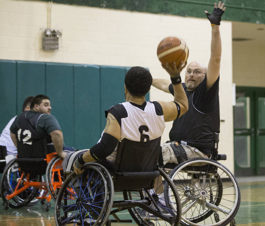 Mike Romanowski, right, reaches out to block the shot of David Gildon during practice for the Las Vegas Yuccas of the National Wheelchair Basketball Association on Tuesday, January 16, 2018, at Ra ...