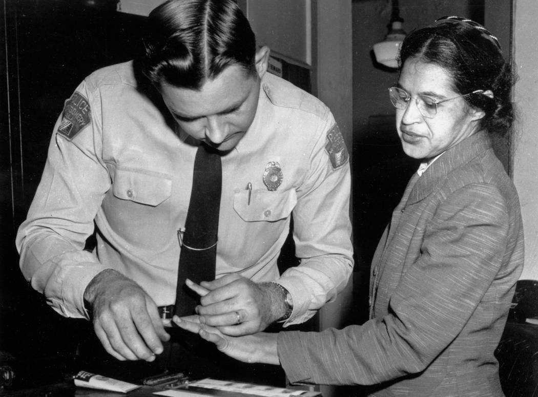 FILE - In this Feb. 22, 1956, file photo, Rosa Parks is fingerprinted by police Lt. D.H. Lackey in Montgomery, Ala., two months after refusing to give up her seat on a bus for a white passenger on ...