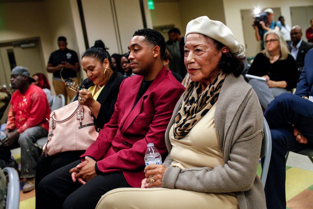 Anna Bailey, 90, right, a former dancer at the Moulin Rouge, sits with her daughter Kimberly Tureaud, 55, left, and grandson Jonathan Backers, 27, center, listen during a town hall meeting at the  ...