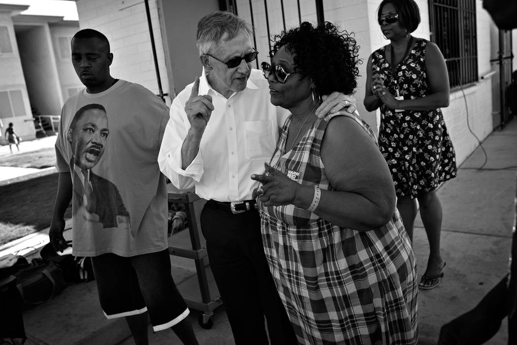 Sen. Harry Reid, in white shirt, speaks with Ruby Duncan while campaigning at a block party in Las Vegas Saturday, Aug. 28, 2010. (Las Vegas Review-Journal)