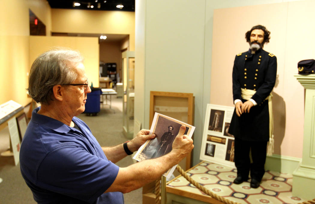 Nevada State Museum Exhibits Manager Tom Dyer shows a reporter part of a traveling exhibit dedicated to the explorer John C. Fremont Wednesday, March 14, 2018. The likeness of Fremont is based on  ...