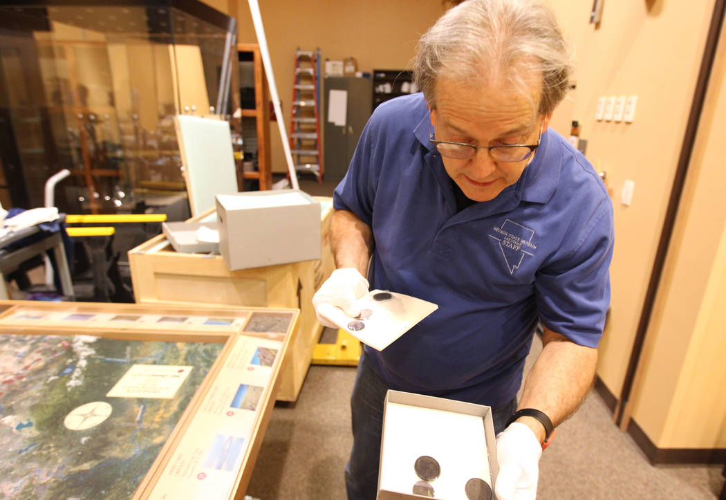 "Nevada State Museum Exhibits Manager Tom Dyer shows a reporter coins that will be part of a traveling exhibit dedicated to the explorer John C. Fremont Wednesday, March 14, 2018. The ""Finding ..."