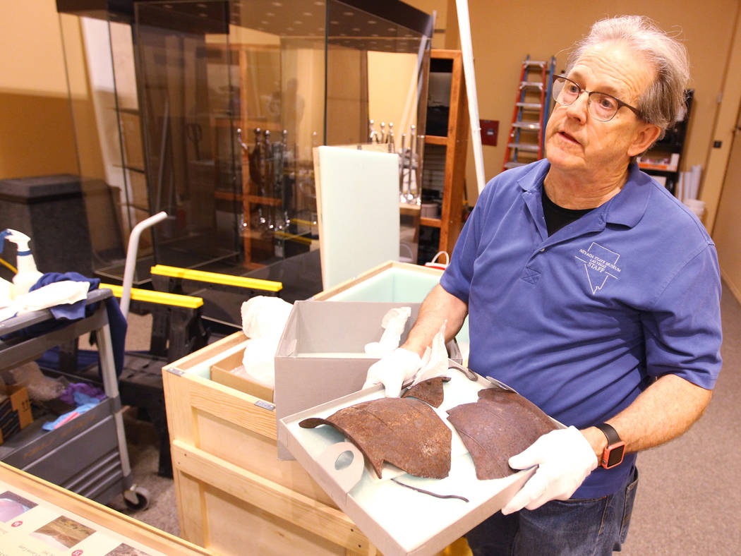 Nevada State Museum Exhibits Manager Tom Dyer shows a reporter broken pottery that will be part of a traveling exhibit dedicated to the explorer John C. Fremont Wednesday, March 14, 2018. The &quo ...