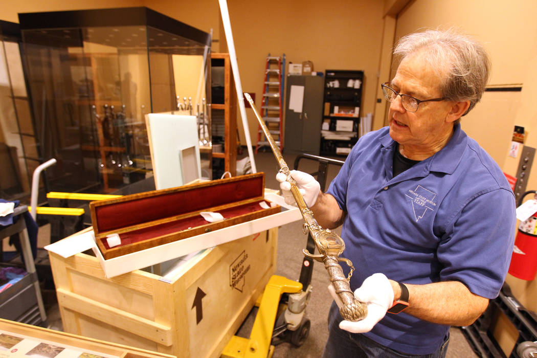 "Nevada State Museum Exhibits Manager Tom Dyer shows a reporter John C. Fremont's sword which will be part of a traveling exhibit dedicated to the explorer Wednesday, March 14, 2018. The ""Find ..."