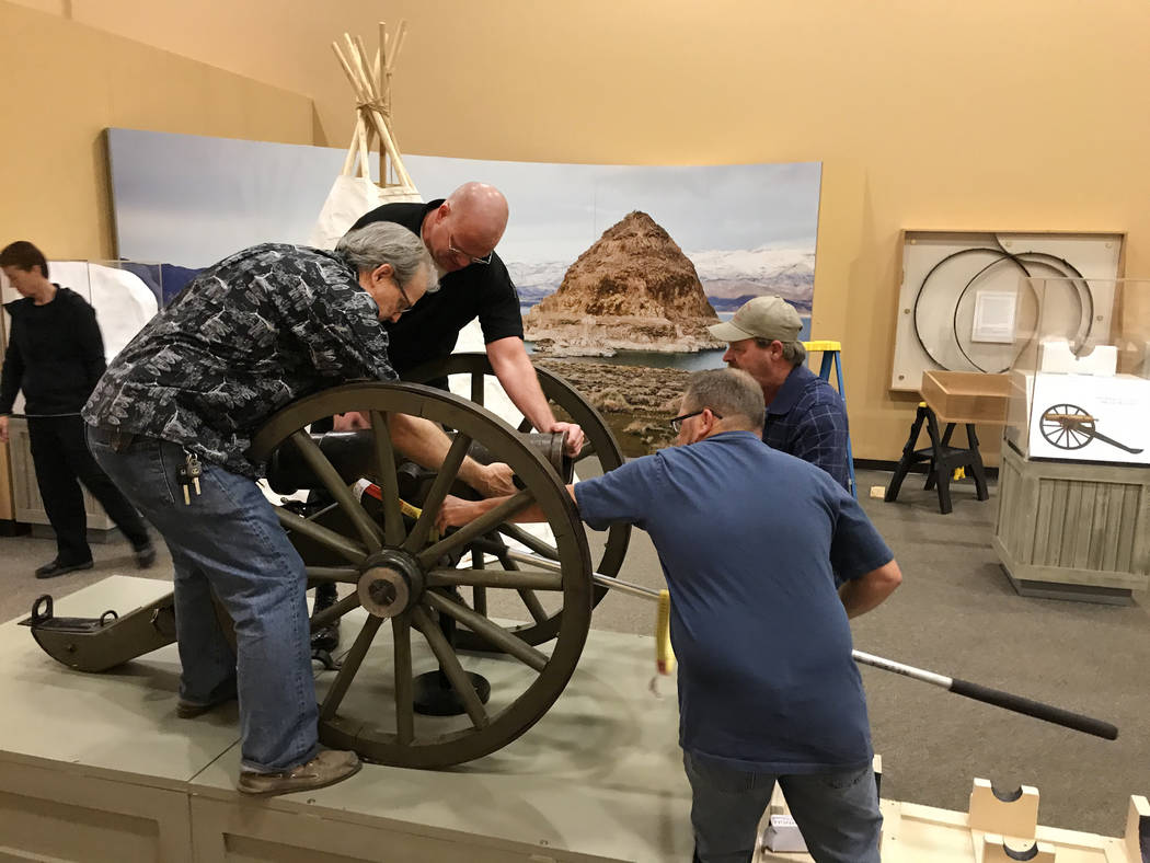 Nevada State Museum staff members, from left, Tom Dyer, Ron McCoy, Wes Sutherland and Dewayne Johnson set up what some scholars believe is the original Fremont Cannon at the museum in Las Veg ...