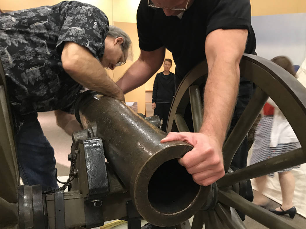 Exhibits manager Tom Dyer, left, and head of security Ron McCoy set up what some scholars believe is the original Fremont Cannon at the Nevada State Museum in Las Vegas on March 23. The  ...