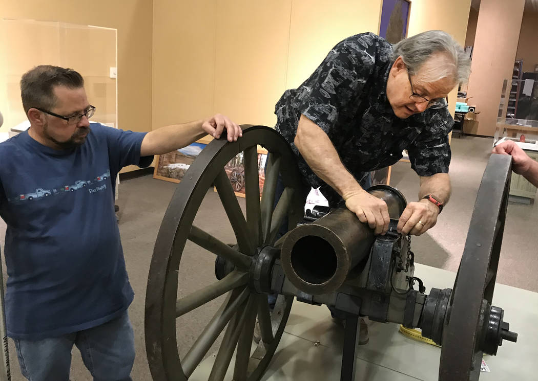 Tom Dyer, exhibits manager for the Nevada State Museum in Las Vegas, secures the Fremont Cannon with a helping hand from exhibits preparator Wes Sutherland on March 23. The cannon is the cent ...