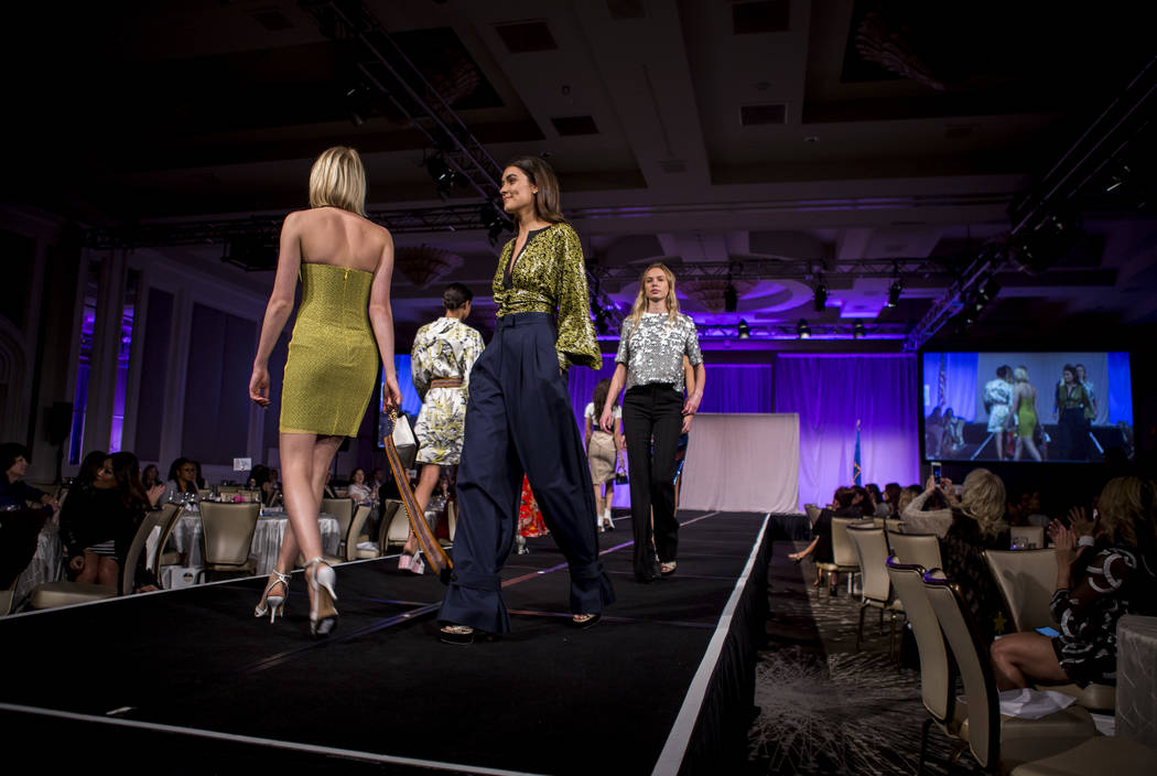 Models wear attire from Diane von Furstenberg during an auction and fashion show by the Clark County Medical Society Alliance to benefit UMC's pediatric unit at the Four Seasons Hotel in Las Vegas ...