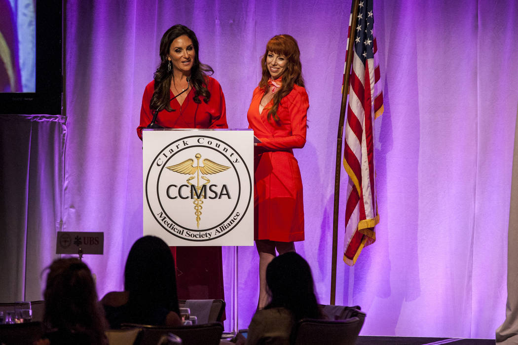 Clark County Medical Society Alliance co-presidents Jessica Kartzinel, left, and Alexia Crowley speak at an auction by the Clark County Medical Society Alliance to benefit UMC's pediatric unit at  ...