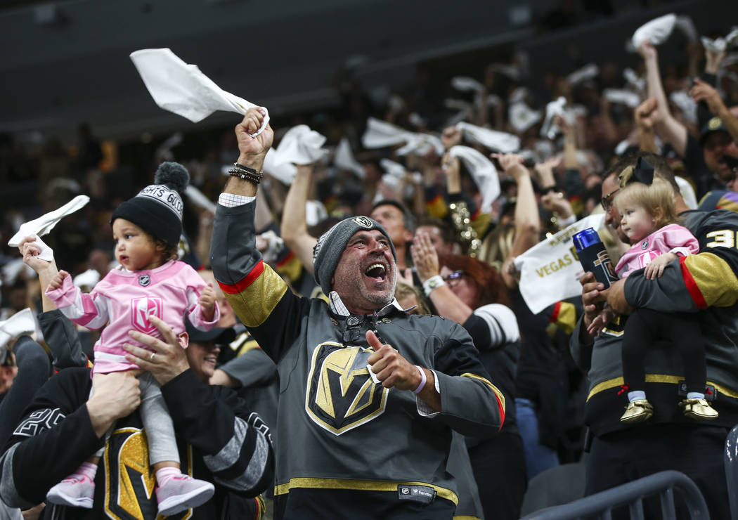 Golden Knights fans celebrate a goal by defenseman Shea Theodore, not pictured, during the first period of Game 1 of an NHL hockey first round playoff series against the Los Angeles Kings at T-Mob ...