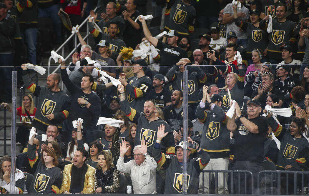 Golden Knights fans cheer during the first period of Game 1 of an NHL hockey first round playoff series against the Los Angeles Kings at T-Mobile Arena in Las Vegas on Wednesday, April 11, 2018. C ...