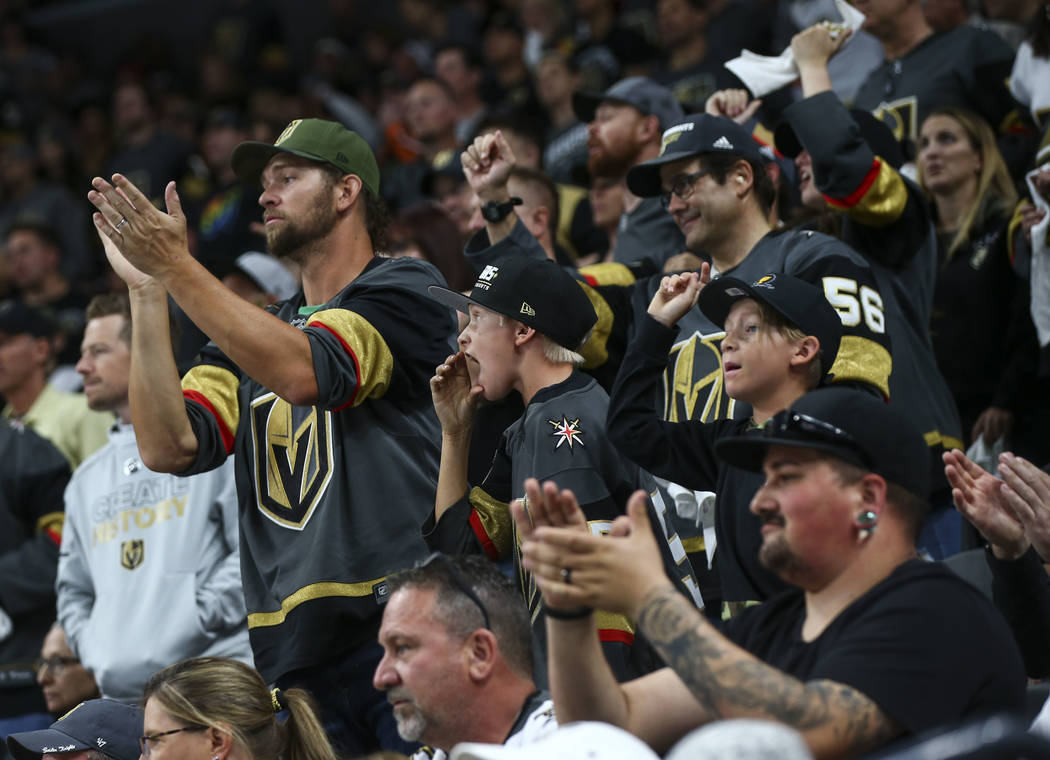 Golden Knights fans shout to Los Angeles Kings players during the second period of Game 1 of an NHL hockey first-round playoff series at T-Mobile Arena in Las Vegas on Wednesday, April 11, 2018. C ...