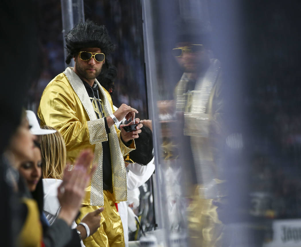 A Golden Knights fan looks on during the second period of Game 1 of an NHL hockey first-round playoff series against the Los Angeles Kings at T-Mobile Arena in Las Vegas on Wednesday, April 11, 20 ...