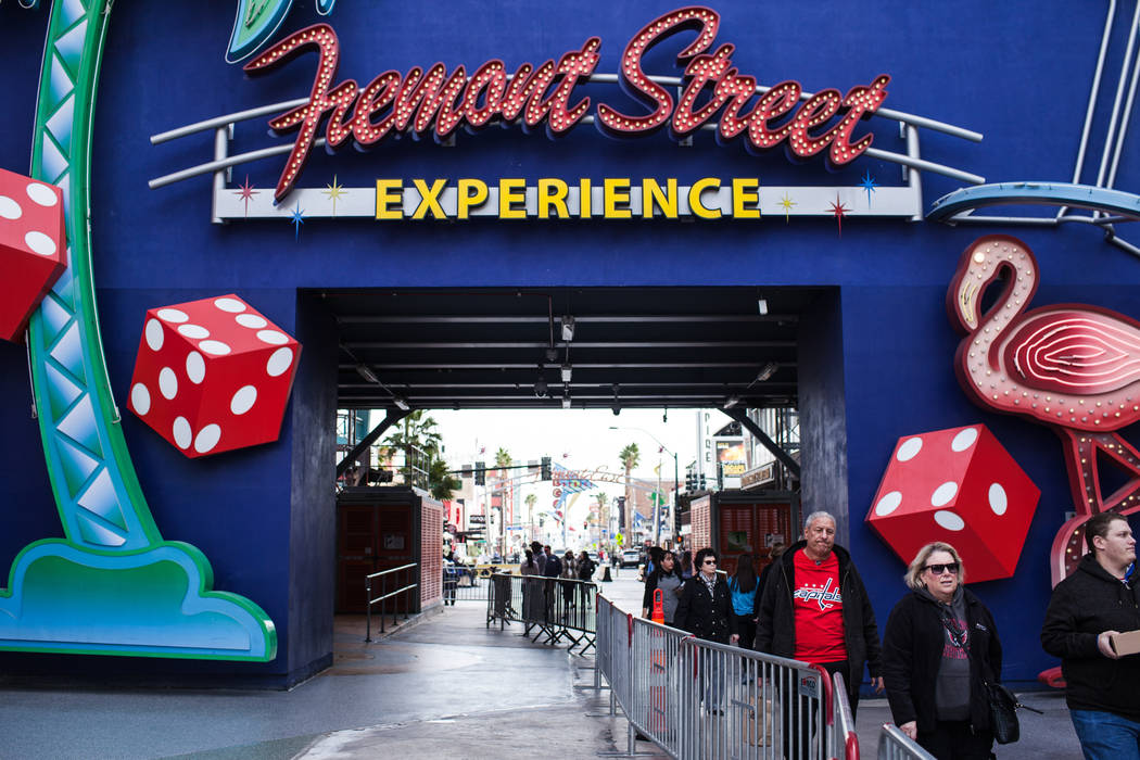 People walk along the Fremont Street Experience as barricades are installed in preparation for New Year's Eve celebrations in Las Vegas, Saturday, Dec. 23, 2017. Joel Angel Juarez Las Vegas Review ...