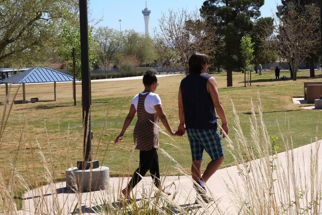 A couple walk at Lorenzi Park on Tuesday, March 1, 2017, in Las Vegas. What should be the most pleasant part of the year in Las Vegas is a pollen-induced nightmare for local allergy sufferers.  (B ...