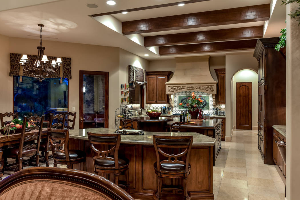 The kitchen has an island with seating. (Today's Realty Inc.)