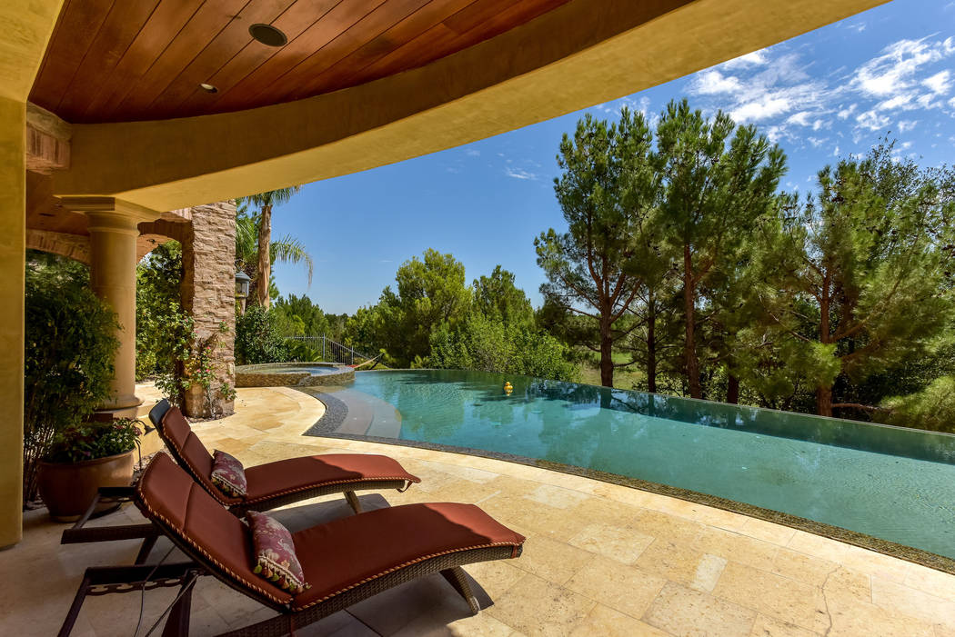 Outside is the pool, spa and lush landscaping. (Today's Realty Inc.)