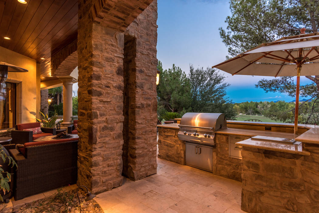 The lush backyard has an outdoor kitchen on the patio. (Today's Realty Inc.)