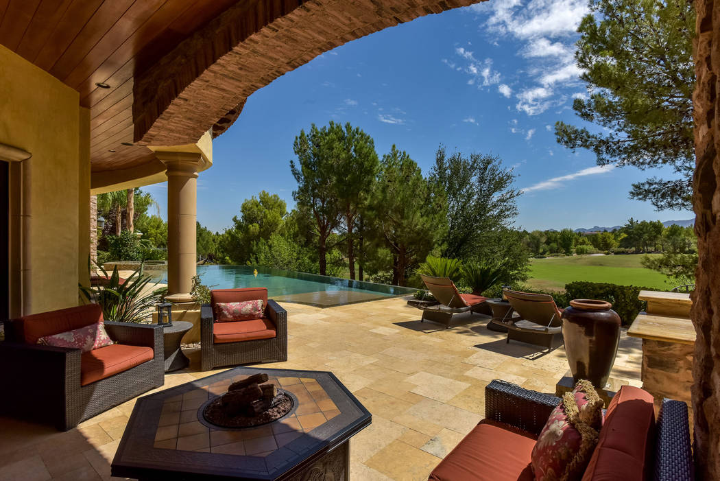 Views of the golf course are a focus point of the home. (Today's Realty Inc.)