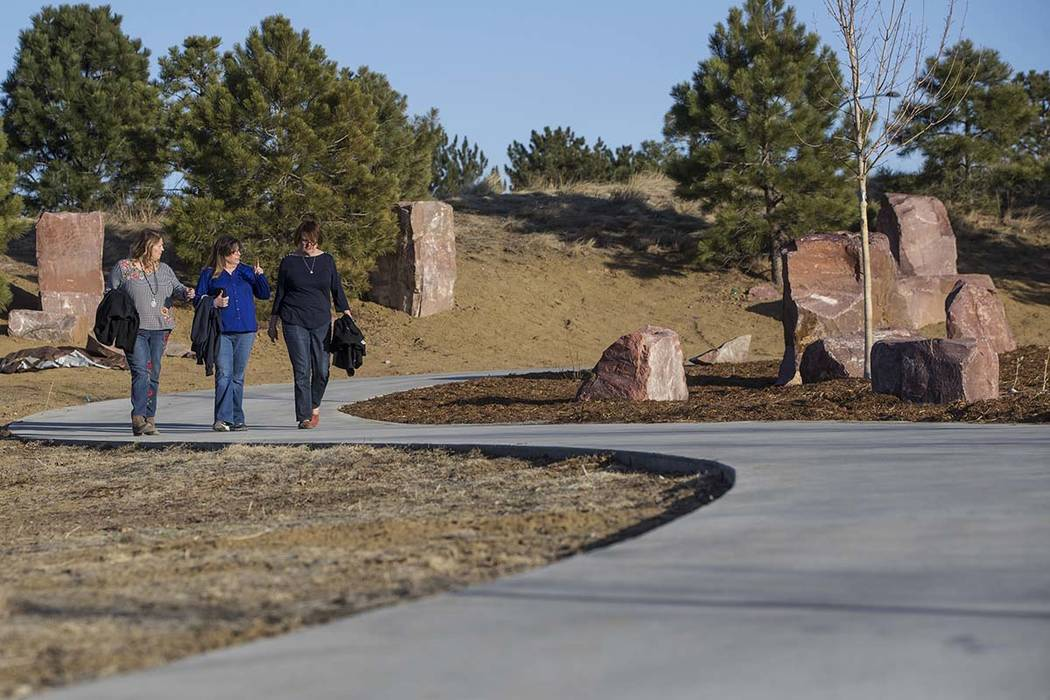 Rena Medek, left, Theresa Hoover and Terry Sullivan walk through Reflection Memorial Garden on Tuesday, March 13, 2018, in Aurora, CO. All three women lost children in the Aurora theater shooting  ...