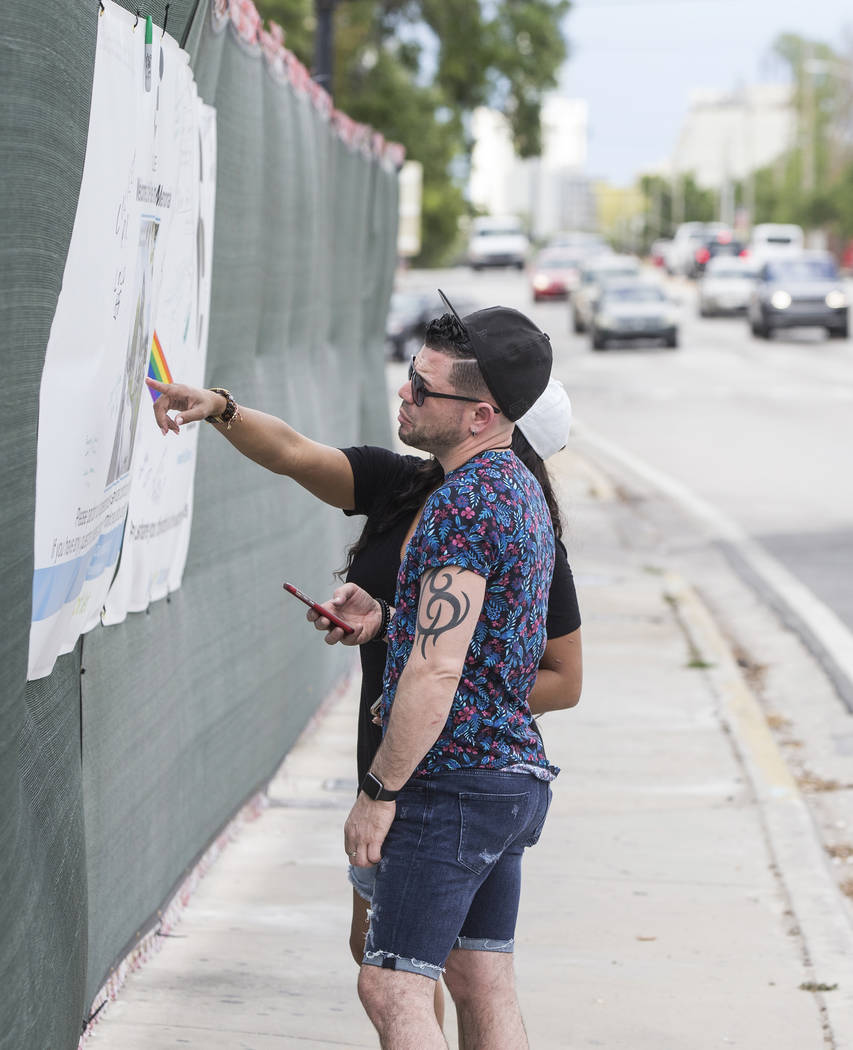 Jose Nieves, front, and Odette Morillo read messages on a banner outside Pulse nightclub on Monday, March 19, 2018, in Orlando, FL. Omar Mateen killed 49 people and wounded 58 inside the club on J ...
