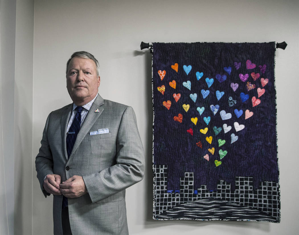 Orlando mayor Buddy Dyer stands next to a donated quilt memorializing the 49 people killed at Pulse nightclub. Photo taken on Tuesday, March 20, 2018, at Orlando City Hall, in Orlando, FL. Benjami ...